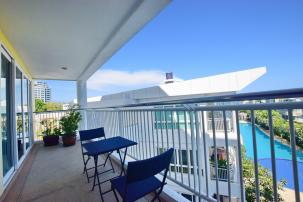 Beautiful 2 Bedroom Beachfront Condominium with Sea and Pool View within walking distance to Market Village and Bluport